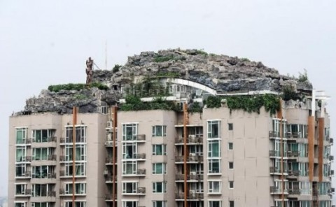 Eccentric Businessman Builds Mountain Villa atop Beijing Apartment Building